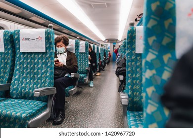 TAIWAN, TAIPEI. DEC 27, 2017: A woman wearing flu mask sitting in Taiwan High Speed Rail (THSR) in the morning in Taiwan, Taipei.