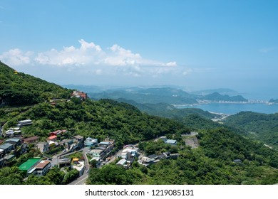 Taiwan . Taipei. Jiufen . December 25, 2017 - 13.00 - Nice view from Jiufen village .We can see Taiwan beach and port .On the hill has many small village mix with the forest.