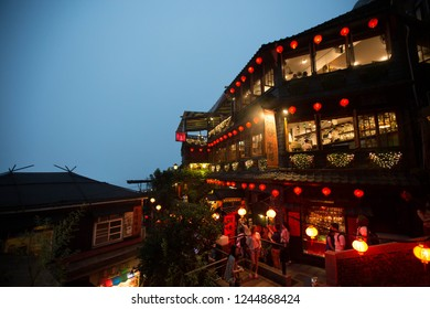 TAIWAN, TAIPEI, JIUFEN - MAY 2013: Tourists visit the famous Jiufen Old Street in Taipei, Taiwan. Jiufen is a popular tourist spot. It was built by japanese and now a maze of lanes and alleyways.