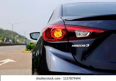 TAIWAN-August 15, 2018: Close-up of Mazda 3 logo, taillight and details on the rear of a blue new Mazda 3 sports sedan.