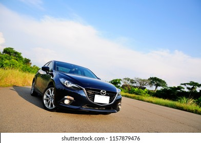 TAIWAN-August 15, 2018: New Mazda 3 captured near the coast on a sunny day. Mazda 3 is a popular compact car manufactured in Japan by the Mazda Motor Corporation.