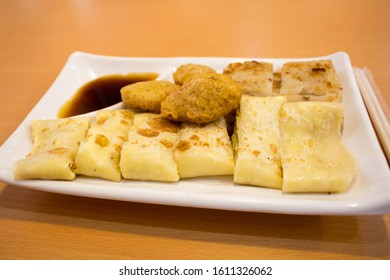 The Taiwanese breakfast meal (Taiwanese egg pancake, radish cake, chicken nugget and source) on plate in restaurant in Taipei, Taiwan.