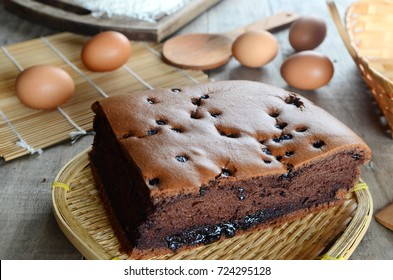 Taiwanese  chocolate sponge cake with bamboo weaving basket on wooden board