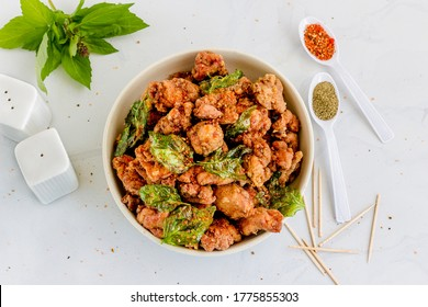 Taiwanese Fried Chicken with Basil Leaves, Spices and Seasonings Top DOwn Street Food Photo