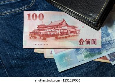 Taiwanese money, Taiwan Banknote, Taiwan dollar on jean background.