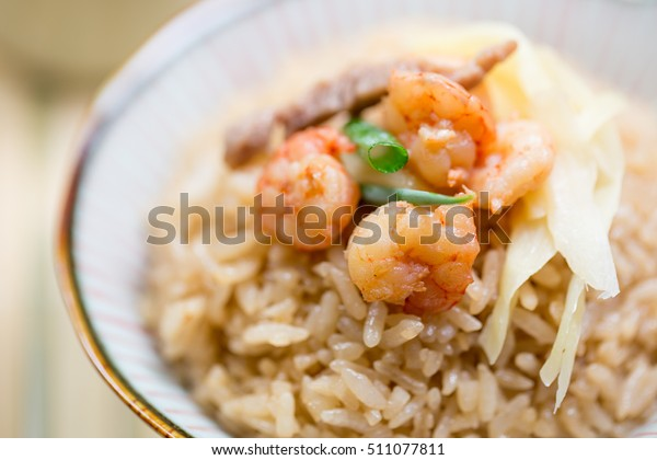 Taiwanese traditional food - Tainan Shrimp rice. With shrimp, ginger, pork, and scallion on top.