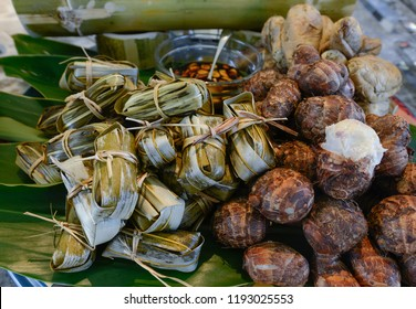 Taiwan's aboriginal traditional food made with glutinous rice & pork wrapped and taro, in leaves on bowl