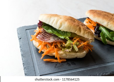Taiwan's Pita Bread Bun Sandwich Gua Bao with Smoked Bacon, Carrot Slices and Greens from Asia Pastrami / Pastirma sandwich