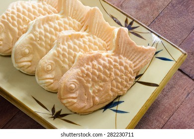 Taiyaki cakes on wood background,Japanese confectionery
