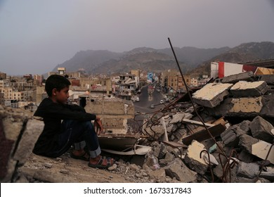 Taiz _Yemen - 22 Aug 2016 : A child from Taiz City sits on the ruins of his ruined home because of the war on city-Yemen.