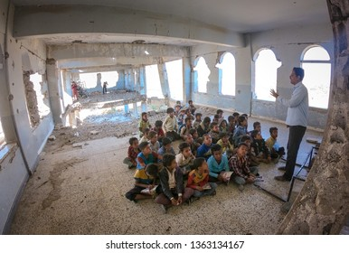 """""""Taiz / Yemen - 01 Apr 2019: Students studying in a school destroyed by the war machine south of Yemen west of the city of Taiz."""""""