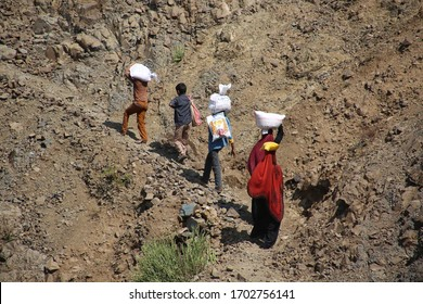 Taiz / Yemen - 02 Apr 2017: Children and women in Yemen transport their food  through the bumpy mountain roads due to the Houthi militia siege of the villages of the Jabal Habashi area west of Taiz
