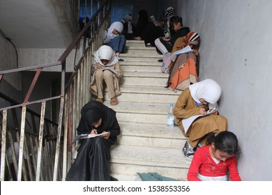Taiz / Yemen - 03 Feb 2016: Children study inside the stairs of the buildings to escape from the indiscriminate shelling by Al-Houthi militia in Taiz City, which destroyed their schools