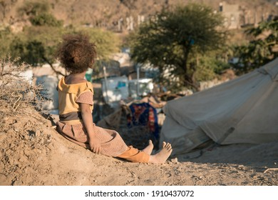 Taiz, Yemen- 04 Feb 2021 : A Yemeni girl lives with her family in a camp for displaced people fleeing the hell of war in the city of Taiz, Yemen