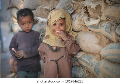 Taiz, Yemen- 04 Feb 2021 :The smile of a poor Yemeni girl who lives with her family in camps for displaced people fleeing the war in the city of Taiz, Yemen