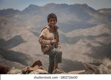 Taiz / Yemen - 04 July 2016 : A poor Yemeni child smiles and looks at the camera in the city of Taiz, Yemen