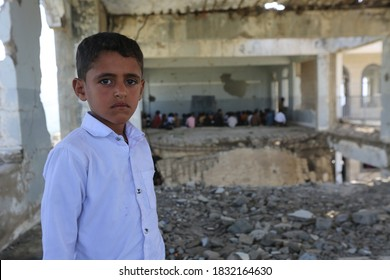 Taiz  Yemen - 07 Oct 2020 :A sad Yemeni child looks at the camera from inside his school, which was destroyed by war, in the city of Taiz, Yemen