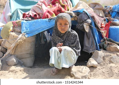 Taiz / Yemen - 09 Feb 2017 : A girl lives outdoors with her family  in a camp for displaced people in Yemen.