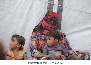 Taiz / Yemen - 11 Apr 2018 :A sad Yemeni woman lives with her child in a camp for people displaced by the war in the city of Taiz, Yemen
