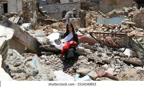 Taiz / Yemen - 13 Apr 2017 : Children in al-Jahmliya neighborhood among the ruins of houses that destroyed by fierce fighting between  al-Houthi militia and the national army in Taiz City,Yemen