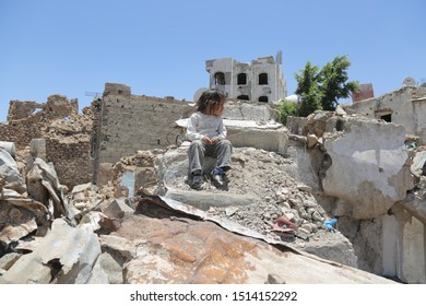 Taiz / Yemen - 13 Apr 2017 : A sad Yemeni girl due to the great destruction left by the violent battles between the National Army and the Houthi militia in the city of Taiz