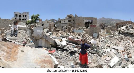 Taiz / Yemen - 13 Apr 2017: Child in  al-Jahmliya neighborhood among the ruins of houses that destroyed by fierce fighting between al-Houthi militia and the national army in Taiz City,