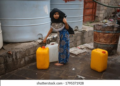 Taiz / Yemen - 13 Aug 2020 :Children fetch water due to the water crisis and the difficult living conditions witnessed by residents of the Taiz city in southern Yemen since the beginning of the war