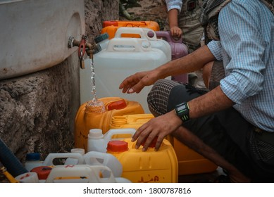 Taiz / Yemen - 13 Aug 2020 : Yemeni children fetch water due to the water crisis and the difficult living conditions witnessed by residents of the Taiz city ibeginning of the war