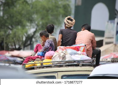 Taiz / Yemen - 17 Apr 2020: Because of the ongoing war and the blockade imposed on Yemen, these children are forced to ride roofs of cars as they travel from Taiz countryside to the city.