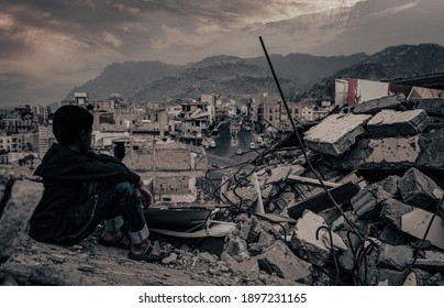 Taiz  Yemen - 22 Aug 2016 : A child from Taiz City sits on the ruins of his ruined home because of the war on city-Yemen.