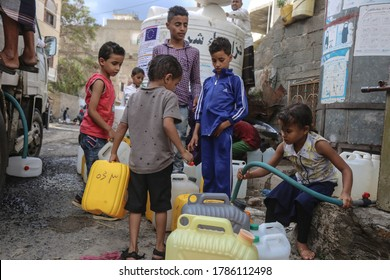 Taiz / Yemen - 29 July 2020 : Children fetch water due to the water crisis and the difficult living conditions witnessed by residents of the Taiz city in southern Yemen since the beginning of the war