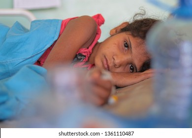 """Taiz / Yemen - 4 Apr 2019: A girl with cholera epidemic and her condition between life and death in the city of Taiz."""