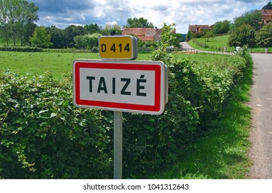 Taizé (Taize)- French commune name in France, Burgundy. Road sign leading towards youth community. Taizé - ecumenical Christian monastic community. Sites of Christian pilgrimage with a focus on youth
