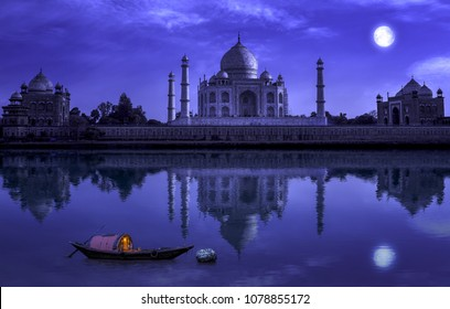 Taj Mahal Agra in full moon night with wooden boat on river Yamuna. Photograph shot from Mehtab Bagh.