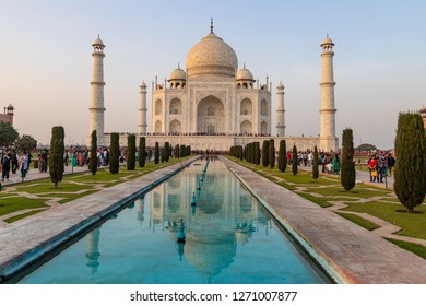 Taj Mahal Agra with Mughal architecture gateway at sunset with water reflection.  India february 21 2018