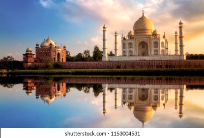 Taj Mahal Agra as seen from Mehtab Bagh at sunset with mirror reflection on Yamuna river.