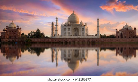 Taj Mahal Agra at twilight from Mehtab Bagh. Taj Mahal is a white marble mausoleum designated as a UNESCO World heritage site at Agra, India.