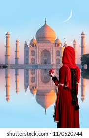 Taj Mahal, Agra   Young woman in traditional indian red clothes