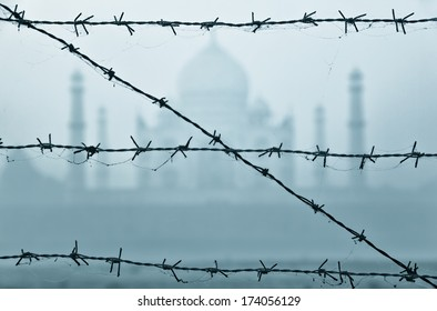 Taj Mahal in India behind barbed wire fences at early morning