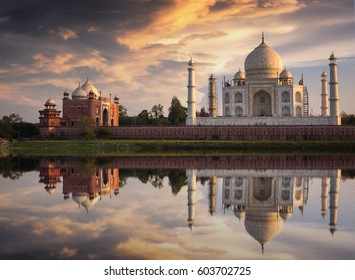 Taj Mahal India at sunset with mirror water reflection effect. Taj Mahal is an architectural wonder and a UNESCO world heritage site on the banks of river Yamuna.