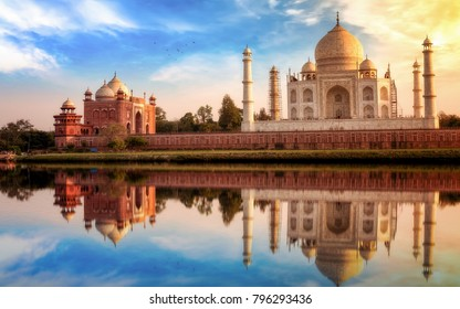 Taj Mahal India at sunset with water reflection. Taj Mahal is a UNESCO World Heritage site at Agra on the banks of river Yamuna.