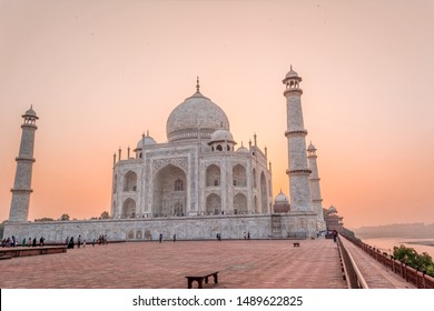 The Taj Mahal is an ivory-white marble mausoleum on the bank of the Yamuna river in the city of Agra, Uttar Pradesh.