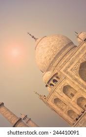 Taj Mahal, landmark of Agra in India during a beautiful orange sunset