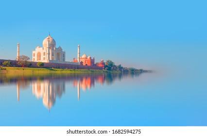 Taj Mahal mausoleum reflected in Yamuna river - Agra, Uttar Pradesh, India