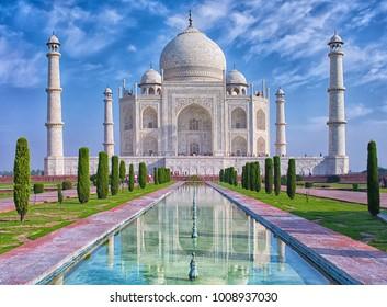 Taj Mahal at morning light with reflection in water in Agra, Uttar Pradesh, India