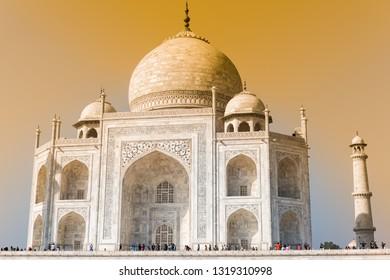 Taj Mahal with orange susnet light, India