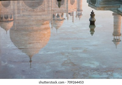 Taj Mahal reflected in a pool on an early morning. UNESCO World Heritage Site and Wonder of the World. Agra, Uttar Pradesh, India.