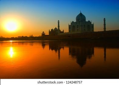 Taj Mahal sunrise reflection in River with blue sky