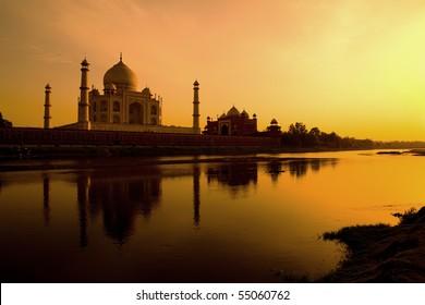Taj Mahal at sunset reflected in the Yamuna river.