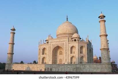 Taj Mahal viewed from east in dawn light with clear blue sky